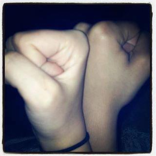 Paris and Michaela's hand