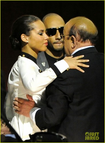 Alicia Keys wallpaper containing a business suit called Alicia Keys Consoles Clive Davis After Whitney Houston's Death