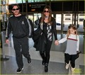 Christian Bale & Family Take Flight - christian-bale photo