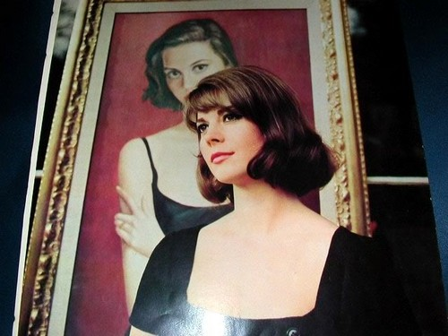 Natalie stand behind the portrait of her