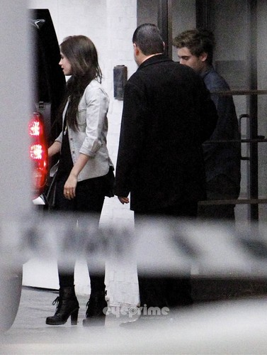 Zac Efron wallpaper probably containing a business suit and a street entitled Zac Efron New Girlfriend? 2012