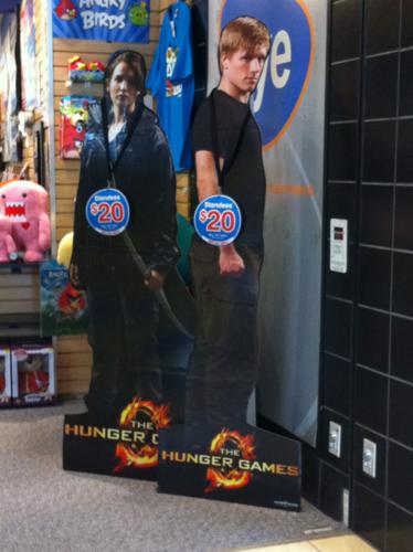 Life-sized Katniss and Peeta standees at FYE