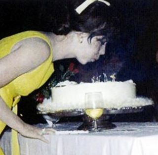 Natalie blows the candles on her birthday cake :)