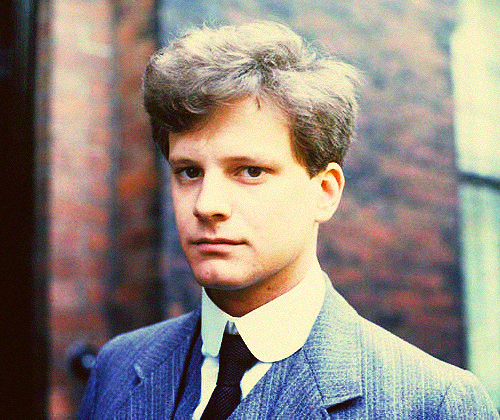 The 80s wallpaper with a business suit called Young Colin Firth