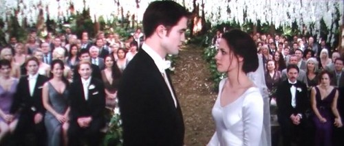 Twilight Series wallpaper with a business suit titled edward and bella getting married