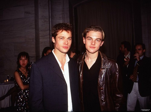 Leonardo DiCaprio Обои containing a business suit, a suit, and a well dressed person entitled Leonardo DiCaprio And Brad Pitt