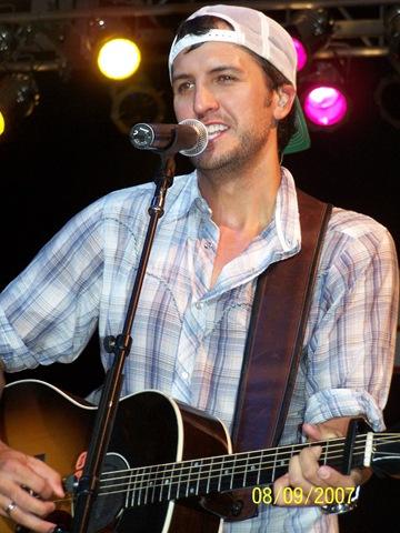 Luke Bryan wallpaper with a guitarist and a concert called Luke Bryan