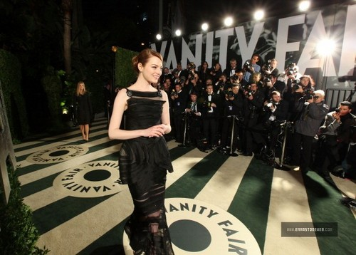 Emma Stone wallpaper possibly with a concert, a well dressed person, and a business suit entitled Emma @ 2012 Vanity Fair Oscar Party [Arriving] - February 26.