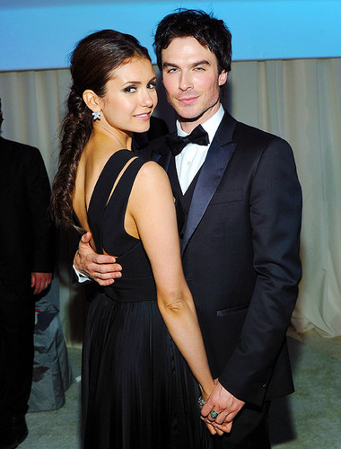 Ian Somerhalder and Nina Dobrev wallpaper probably containing a business suit and a dress suit called Holding Hands!!!!!