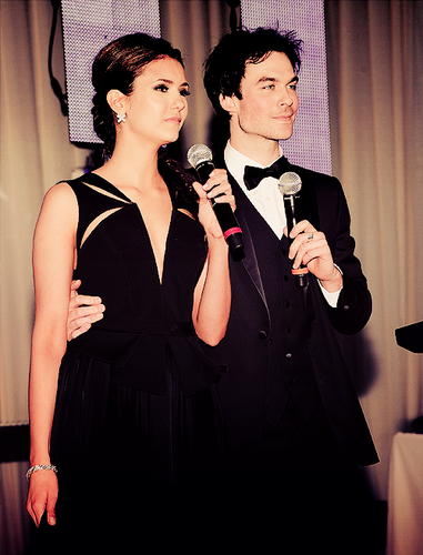 Ian with his arm around Nina's waist. ♥