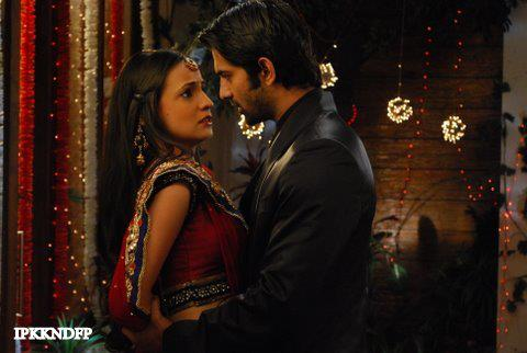 Iss Pyar Ko Kya Naam Doon wallpaper possibly containing a business suit called Khushi and Arnav