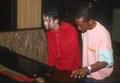 Michael plays the piano. - michael-jackson photo