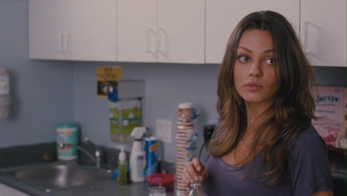 Mila Kunis Hintergrund possibly with a kitchen, a kitchenette, and a stove called Mila Kunis as Cindy in 'Extract'