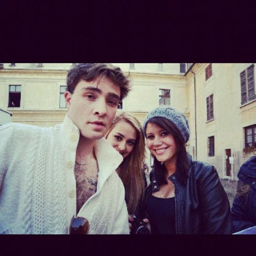 Ed Westwick Hintergrund probably with a street, a sign, and an outerwear called Ed Westwick in Mantova (Italy)