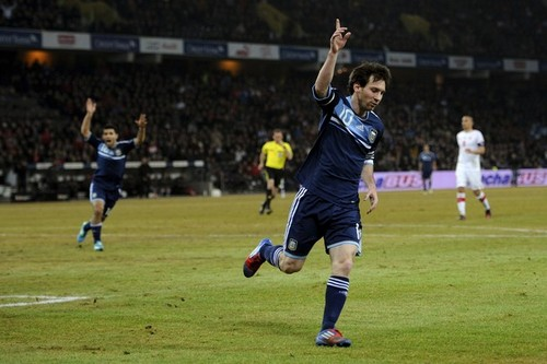 Lionel Andres Messi wallpaper with a soccer player and a fullback entitled Lionel Messi Hattrick in Argentina Friendly vs Switzerland (1-3) 29 February 2012