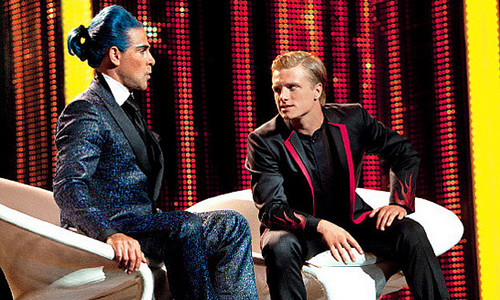 The Hunger Games پیپر وال with a business suit entitled Peeta and Ceaser