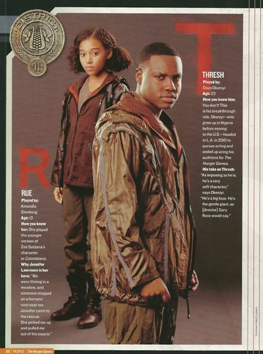 The Hunger Games Movie wallpaper possibly with a green beret entitled Rue and Thresh