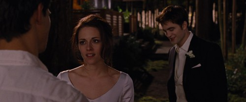 Edward Cullen wallpaper with a business suit and a bridesmaid titled Breaking Dawn Part 1 [Movie Screencaps]