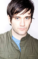 Colin Donnell as Tommy Merlyn