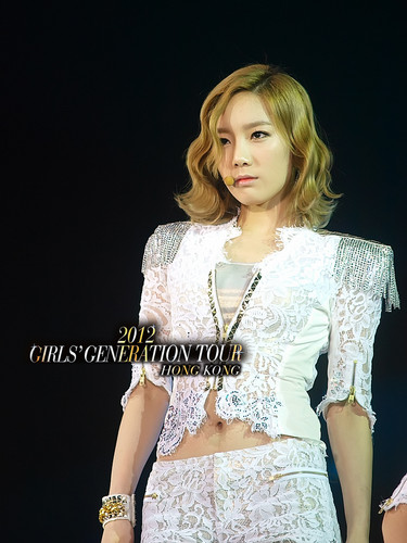 Kim Taeyeon wallpaper probably containing a dinner dress entitled Taeyeon @ Girls' Generation 2nd Asia Tour in Hong Kong