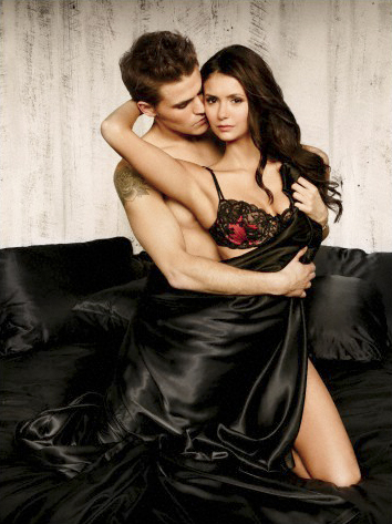 Paul Wesley and Nina Dobrev wallpaper probably containing a dinner dress and a cocktail dress entitled Dobley
