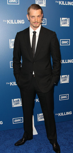 "Joel Kinnaman achtergrond containing a business suit, a suit, and a single breasted suit titled Joel Kinnaman - Premiere Of AMC's Series ""The Killing"" - Arrivals"