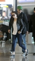 Kristen Stewart & Robert Pattinson arrive at Roissy Airport in Paris, France - March 8, 2012. - kristen-stewart photo