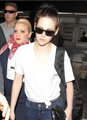 Kristen Stewart & Robert Pattinson at LAX airport in Los Angeles, California - March 8, 2012.