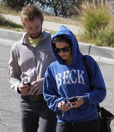 Nikki Reed & Paul McDonald out with their German Shepherds in a park in Hollywood - March 7, 2012.