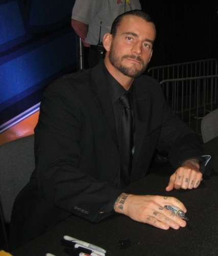 CM Punk wallpaper with a business suit titled Punk In A Suit