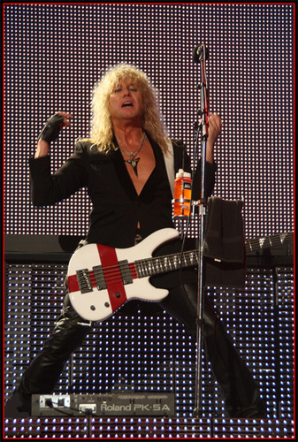 Rick Savage wallpaper with a guitarist and a concert called Sav