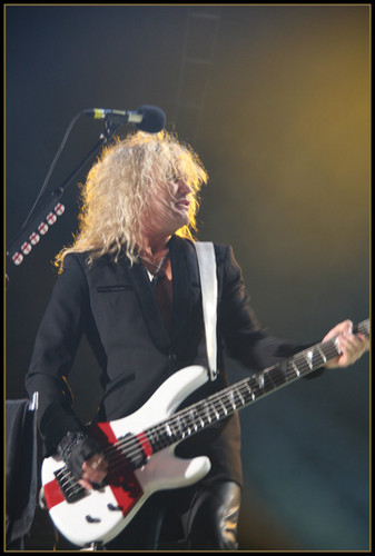 Rick Savage wallpaper with a guitarist and a concert titled Sav