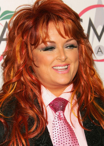 Wynonna Judd kertas dinding possibly with a business suit and a portrait titled Wynonna Judd