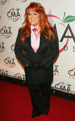 Wynonna Judd achtergrond with a business suit, a suit, and a well dressed person entitled Wynonna Judd