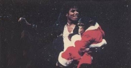 Michael Jackson and Bubbles Jackson Bubbles wearing Santa Costume cute (: