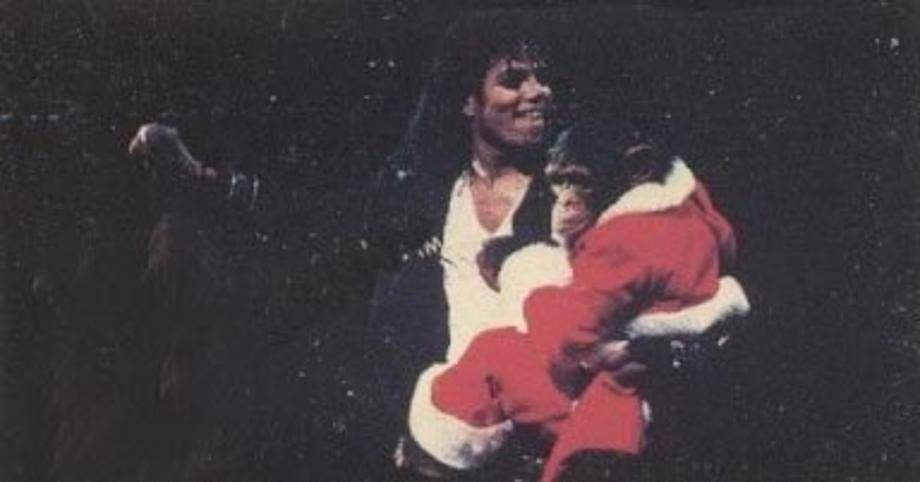 Michael Jackson and Bubbles Jackson Bubbles wearing Santa Costume cute (: - michael-jackson photo