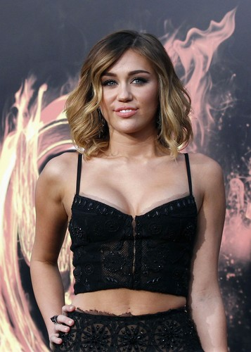 Miley-Miley - 12. March- The Hunger Games Premiere at the Nokia Theater in LA: Red Carpet