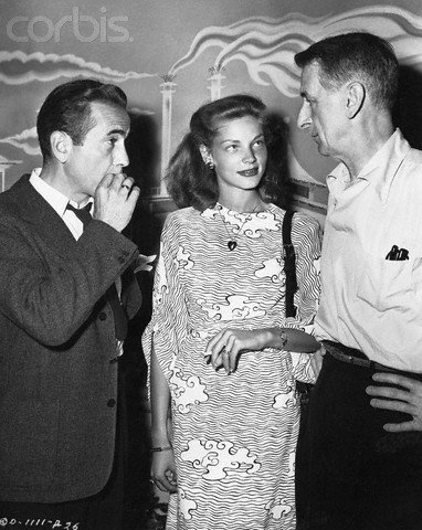 phim cổ điển hình nền possibly containing a business suit and a dress suit titled Humphrey Bogart, Lauren Bacall & John Cromwell