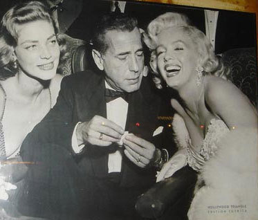 Classic Movies wallpaper possibly containing a business suit called Lauren Bacall, Humphrey Bogart & Marilyn Monroe