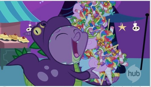 Spike eating Candy