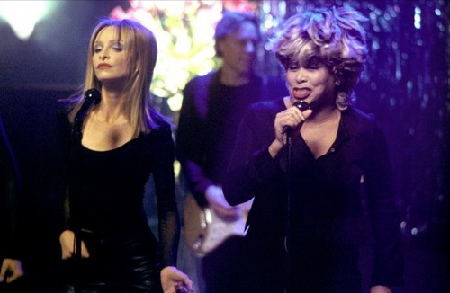 Ally Mcbeal wallpaper with a concert entitled Tina Turner and Ally McBeal
