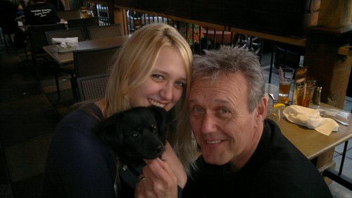 Tony and Emily with a puppy