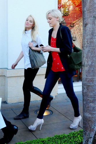 Amber Heard sneaks a smile while out with a friend in Los Angeles