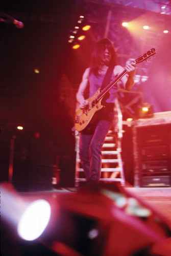 AC/DC wallpaper with a guitarist and a concert titled Malcolm Young