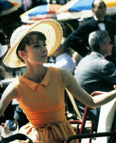 Audrey Hepburn wallpaper containing a sombrero, a boater, and a snap brim hat titled Audrey Hepburn