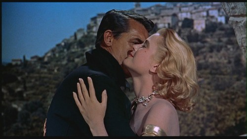 """Grace Kelly wallpaper possibly containing a sign and a portrait entitled Grace Kelly in """"To Catch a Thief"""""""