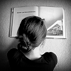 Reading photo possibly containing a portrait entitled Reading