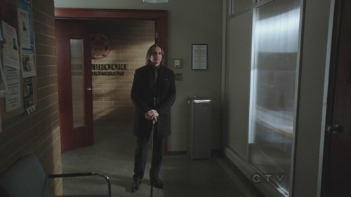 Rumpelstiltskin/Mr. Gold wallpaper with a business suit and a revolving door titled 1x17 - Hat Trick