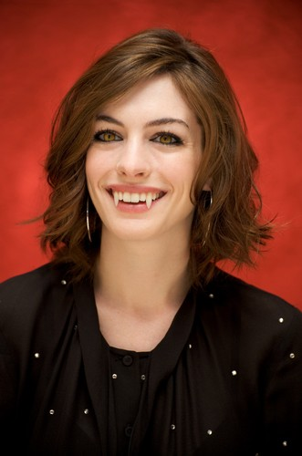 Anne Hathaway Shows Fangs - ali-larter Photo