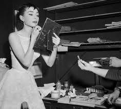 Audrey putting lipstick on
